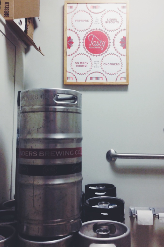 Michigan beer kegs in an NC bottle shop Bathroom